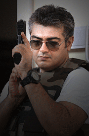 arrambam-ajith-cooling-glass-with-gun