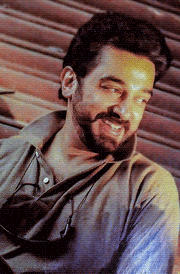 nammavar-kamal-smile-wallpaper