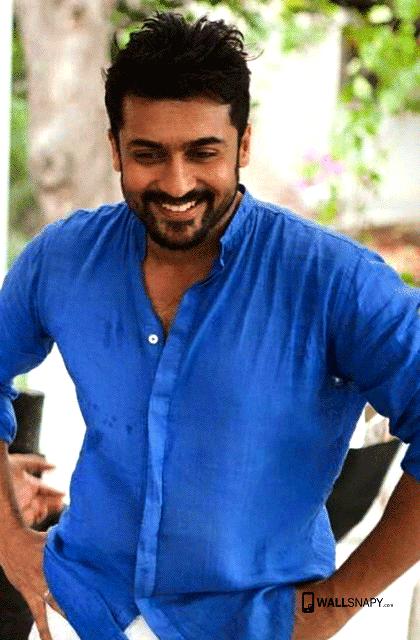 Smiling Surya Blue Shirt Hd Wallpaper Wallsnapy